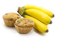 Bunch of bananas and raisin cup cake Royalty Free Stock Images