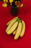 Bunch of bananas on red  background. Fresh organic Banana, Fresh bananas on kitchen table Royalty Free Stock Photo