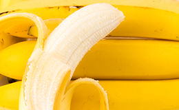 Bunch of Bananas. A bunch of Bananas  in a row with a peeled banana on top Stock Photography