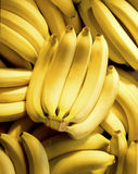 Bunch of bananas. On top of more bananas stock photo