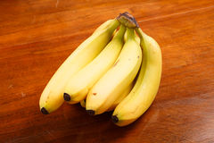Bunch of Bananas on a Wood Table Stock Photography