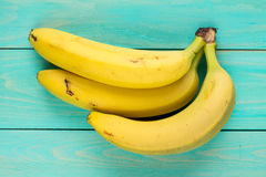 Bunch of bananas on wooden background Royalty Free Stock Images
