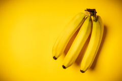Bunch of bananas on a yellow background. Some delicious and fresh banana on a yellow background Stock Images