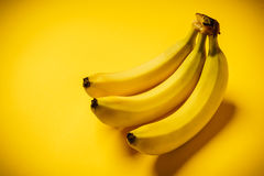 Bunch of bananas on a yellow background. Some delicious and fresh banana on a yellow background Stock Photography