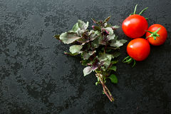 Bunch of basil and tomatoes Stock Photography