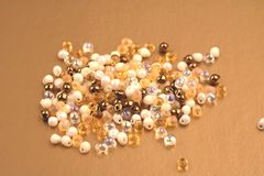Bunch of beads of golden bright shades. stock photo