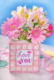 Bunch of beautiful pink flowers and frame with text Stock Photos