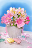 Bunch of beautiful pink flowers in wooden bucket Royalty Free Stock Photography