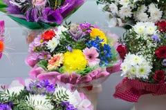 bunch of big fresh orange pink red gerbera chamomile and big white yellow blue chrysanthemum flower Stock Image