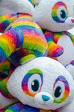 Bunch of big rainbow stuffed bears stock photo