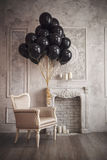 Bunch of black balloons in home interior Royalty Free Stock Photos