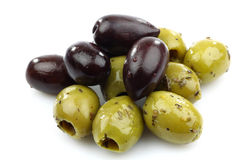 Bunch of black and seasoned green olives Royalty Free Stock Images