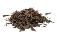 Bunch of black tea leaves. On a white background stock photo