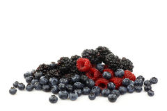 Bunch of blackberries, raspberries and blueberries. On a white background Stock Images