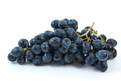 Bunch of blue grapes. Isolated on the white background Royalty Free Stock Photography