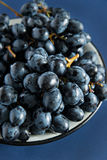 Bunch of blue grapes in a bowl Stock Photo