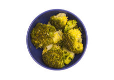 Bunch of boiled green broccoli on plate Stock Photos