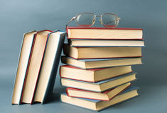 Bunch of books and reading glasses Royalty Free Stock Photo