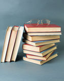 Bunch of books and reading glasses Stock Photo