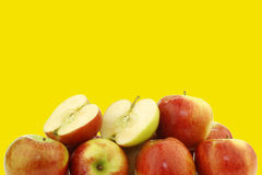 Bunch of braeburn apples and a cut one Stock Photography