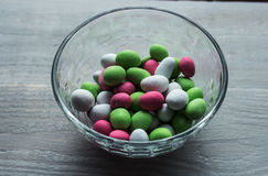 Bunch of bright candy in bowl Stock Images
