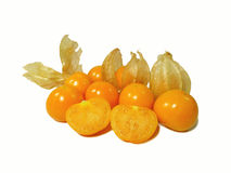 Bunch of bright orange yellow ripe Cape gooseberries, some with calyx, some cut in half. Isolated on white background Stock Photography