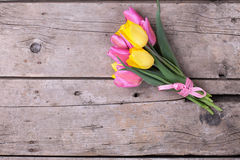 Bunch of bright yellow and pink spring tulips on wooden backgrou Stock Images