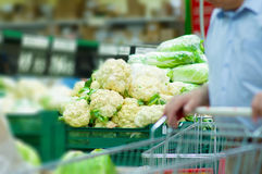 Bunch of broccoli and chinese cabbage in shop Stock Image