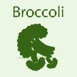 Bunch of broccoli at the light green background. With hand drawn word Broccoli Stock Photo