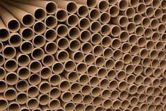 A bunch of brown industrial paper core. A lot of paper cores or paper tubes. Brown paper rolls royalty free stock image