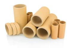 A bunch of brown industrial paper core on white background with shadow reflection. A lot of paper cores or paper tubes on white backdrop. Brown paper rolls stock photos