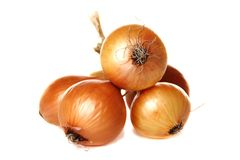Bunch of brown onions on a white background. Royalty Free Stock Images