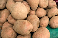 A bunch of brown potatoes on the market. Novi Sad, Serbia Royalty Free Stock Photo