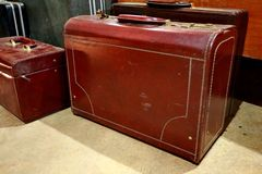 A bunch of brown suitcases. Antique luggage. Vintage travel bag. which is still feasible, but only a decoration stock photo