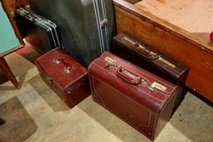 A bunch of brown suitcases. Antique luggage. Vintage travel bag. which is still feasible, but only a decoration royalty free stock image