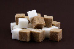 Bunch of lump sugar on a brown background Royalty Free Stock Photos