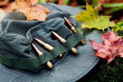 Bunch of bullets and military hat. Bunch of bullets lying in a military hat Royalty Free Stock Photos