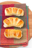 A bunch of buns on the kitchen tablecloth Royalty Free Stock Image