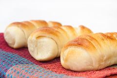 A bunch of buns on the kitchen tablecloth Royalty Free Stock Images