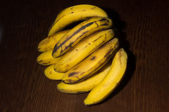 Bunch of canary bananas. In a wooden background Stock Photos