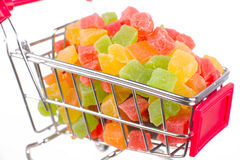 A bunch of candied fruits in a shopping trolley. Isolated on white Stock Images
