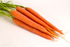 Bunch of Carrots. Bunch of raw carrots with green tops attached Royalty Free Stock Photo
