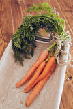 Bunch of carrots. A bunch of carrots with leafs in a basket Stock Photo