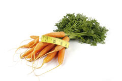 Bunch of Carrots with Tape Measure Royalty Free Stock Images