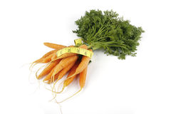 Bunch of Carrots with Tape Measure Stock Image