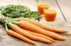 Bunch of carrots on wooden table Stock Images