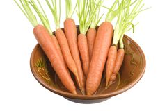 Bunch of carrotts in a bowl. Controlled biological cultivation, isolated on white background Stock Images