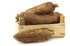 Bunch of cassava roots in a wooden crate stock photos