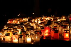Bunch of cemetery candles in a dark stock photos