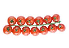 Bunch of cherry tomatoes. Bunch of ripe red cherry tomatoes isolated on white Stock Images